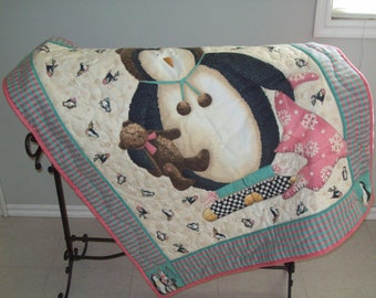 Penguin in creme, brown, coral and green cotton flannel baby quilt