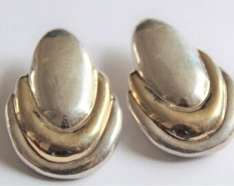 1980s earrings.  Clip on earrings. Very big earrings. Gold and silver earrings