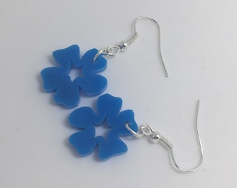 Small Flower blue Earrings. Laser cut from acrylic. by Emily M A Parkin