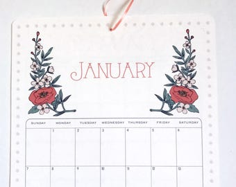 2018 Wall Calendar, Size 11x17 Inches featuring 12 different illustrations in sage, peach, gold, gray, pink, and coral