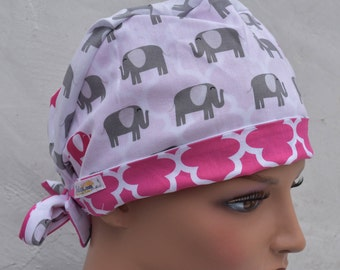 Tie Back Scrub Cap scrub hat featuring a white material with gray and pink elephants with a coordinating band 2t
