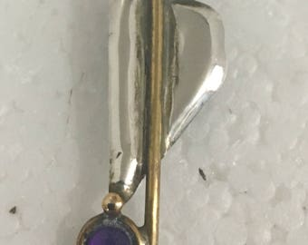 Sterling silver pendant with brass accents and amethyst stones