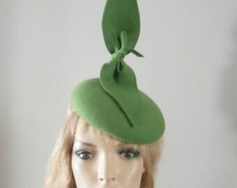 hand made,bespoke green felt beret hat with sculptured  bow detail.