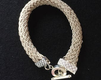Chunky braided cord beige bracelet with silver plated T-bar clasp