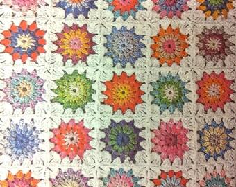 Multicolored and white crochet napkin