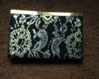 Black gold and silver purse.