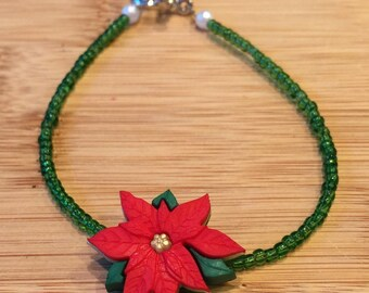 Red Poinsettia button on glass seed beaded bracelet