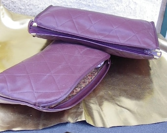 2 beautiful toiletry bags in a material very soft imitation leather 30 x 20 and 27 x 18