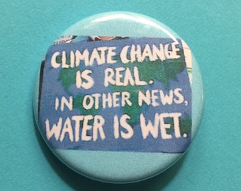 Climate Change is Real 1.25 inch pinback
