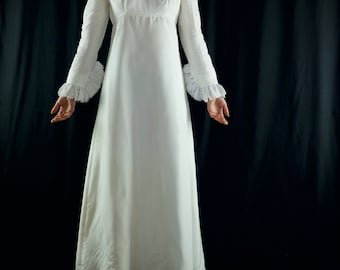1960's modest wedding dress with daisy lace hemmed sleeves