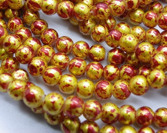 139 glass beads 6 mm painted bomb red with gold