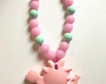 Chompy Dino Babywearing Accessory-Pink