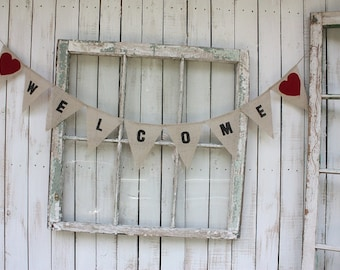 Welcome burlap banner with red hearts