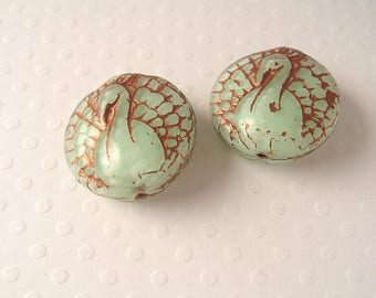 2 Peacock green with copper water 18mm glass pearls