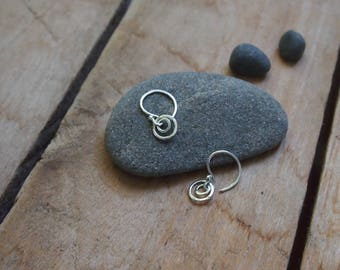 Tiny sterling silver hoops. Tiny circles.