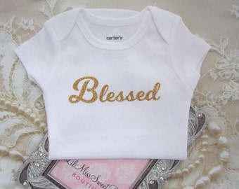 Our Girl's Blessed Bodysuit. Vinyl letters on White a Carter's one piece. Buy ONE for a baby shower gift. By Lil Miss Sweet Pea