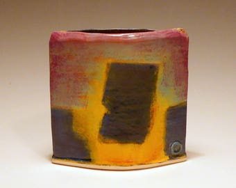 Hand built oval slab pot with abstract design