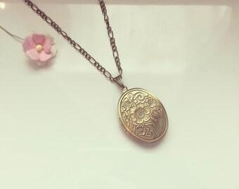 Long chain with charm, symbol, faith