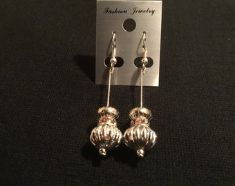 Beautiful all silver earrings with color spots on them
