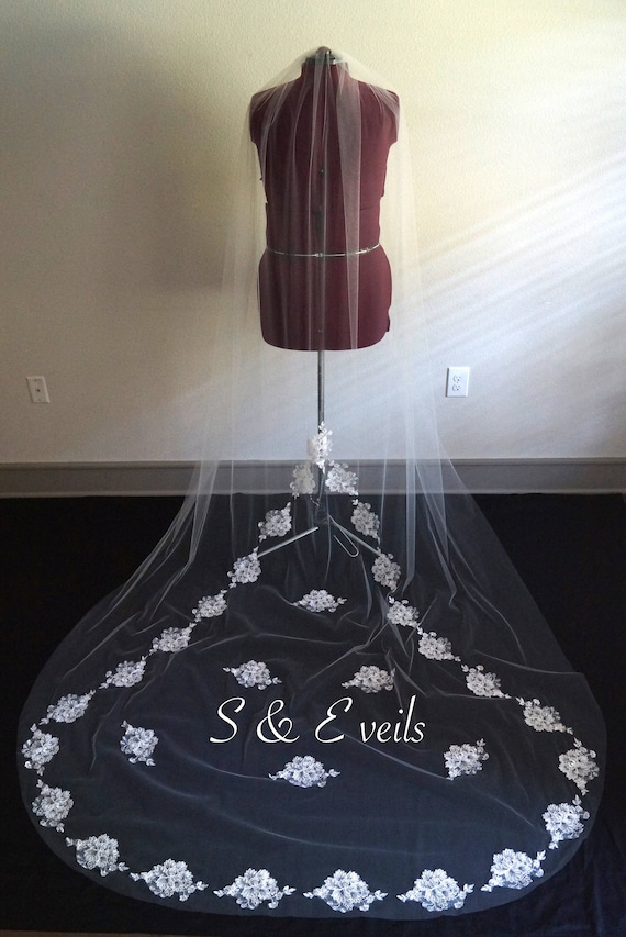 Wedding Veil with Lace Appliques dragging behind the bride