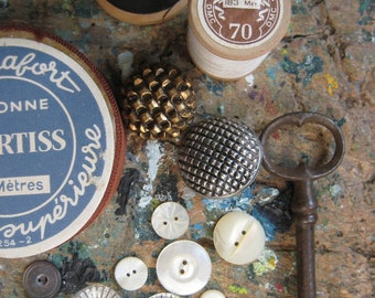 A collection of vintage French haberdashery, instant collection, sewing notions, buttons, well, bobbins, thread, ribbon, vintage key
