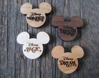 Hardwood engraved Mickeys.  Your choice of magnet or ornament.