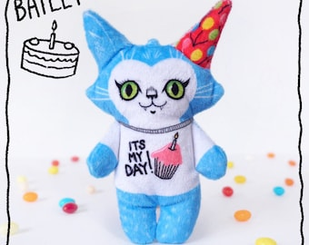 Birthday Bailey the cat- plush stuffed doll ready for a party