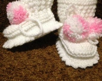 White baby boy boots.  3-6 Months  from acrylic yarn. Booties knitted