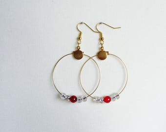 Gold earrings with transparent and red pearls
