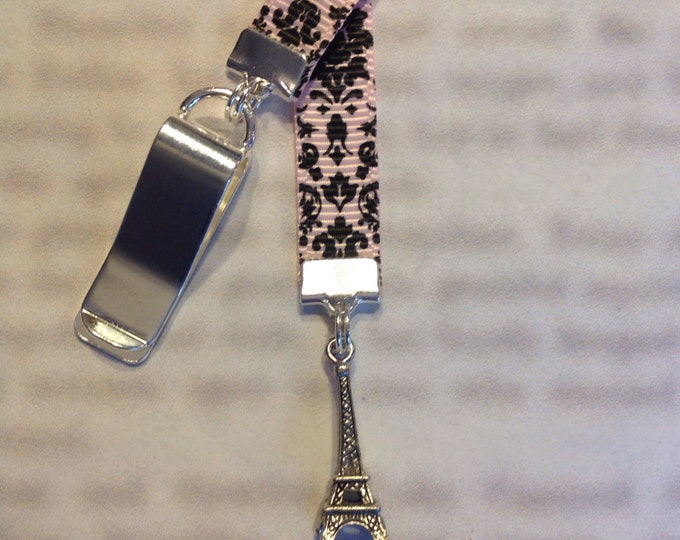 Featured listing image: Eiffel Tower Bookmark / Paris Bookmark / French Bookmark /Attach to book cover then mark the page with the ribbon. Never lose your bookmark!