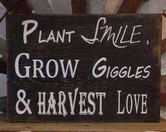 plant smile grow sign