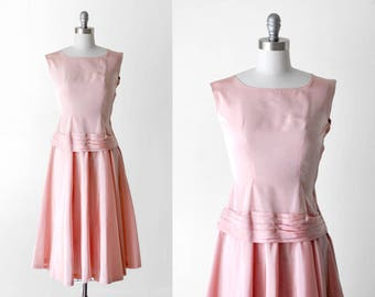 1950's pink taffeta dress. s. 50's drop waist dress. full skirt. pastel.