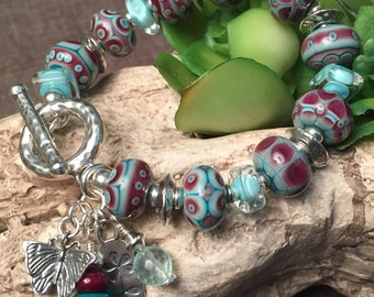 RASPBERRY ICE, artisan lampwork and sterling silver bracelet