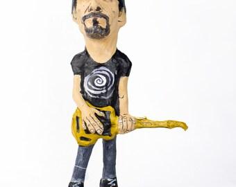 The Edge U2 paper mache figure