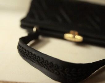 1950s black fabric evening handbag, vintage 50s handbag, folded fabric.