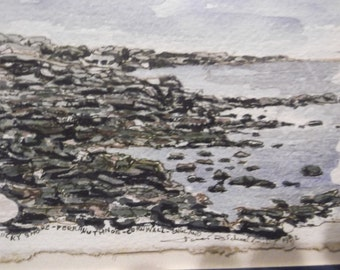 Watercolor of the rocky shore of cornwall England.