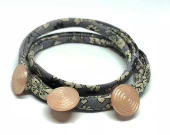 Purple double bracelet with soft pink buttons