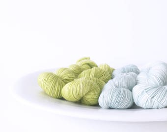 Kettle Dyed Yarn Superwash Merino . Fingering . 400 yards . 100 g . Moonlight . Shades of Green . Colorway Mint and Lime