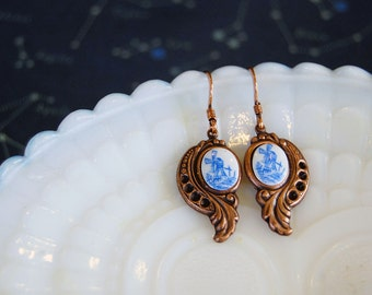 vintage windmill copper dangle earrings- feathered scroll detail