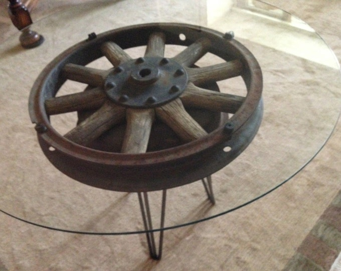 """Antique wooden 18 inch truck wheel accent table  with 30"""" diameter glass top"""