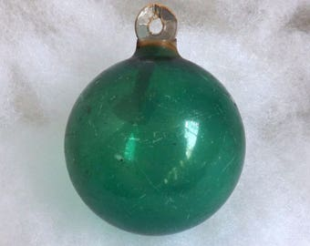 Vintage Christmas ornament unsilvered WWII paper cap glass ball green