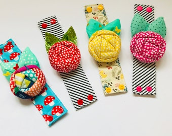 A modern fun Wrist Rose Pincushion In various colours and styles for sewing