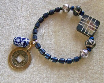 Blue hematite boho bracelet with a touch of the Orient.