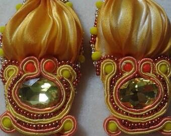 Handmade earrings with beading and shibori silk weaving