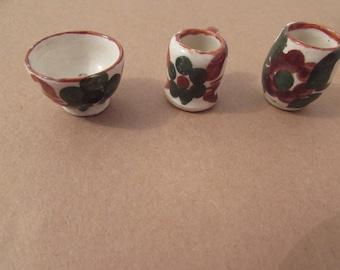 lots of miniature ceramic vases