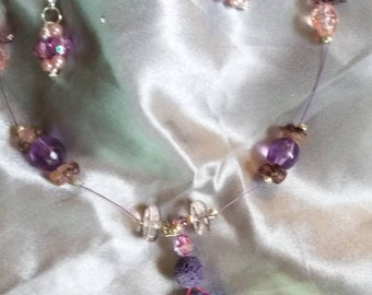 Purple and sparkly diffuser necklace.