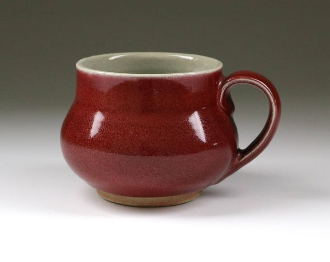 Wheel-thrown stoneware pottery coffee or tea mug with copper red reduction glaze