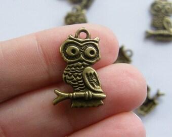 8 Owl charms antique bronze tone BC186