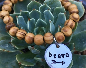 Wood beaded bracelet + hand stamped brave charm - be brave - inspirational jewelry - arrow -  Love Squared Designs