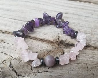 Fairy Dreams A Stretchy bracelet made with Amethyst, Rose Quartz, and a Lilac Lepidolite focal bead centered between Hematite spacers